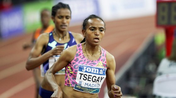 epa09034460 Gudaf Tsegay of Ethiopia on her way to win the gold in the 3000 meters final of the Villa de Madrid International Athletic Competition in Madrid, Spain, 24 February 2021, in the framework of the World Athletics Indoor Tour Gold.  EPA/Kiko Huesca