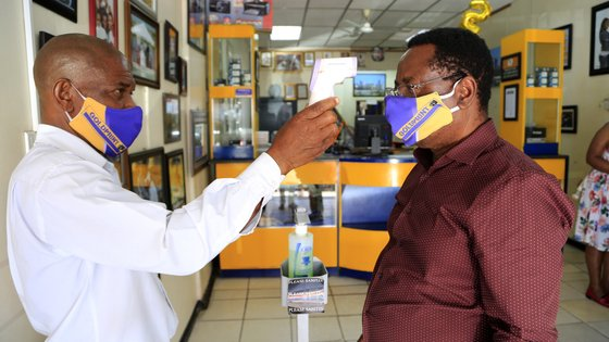epa08757350 A man has his skin temperature checked in a shop Harare, Zimbabwe, 19 October 2020. According to the World Health Organisation (WHO), Africa faces a reality check in its fight against the coronavirus pandemic as cases and deaths rise after easing lockdowns and travel restrictions. The continent has seen an increase in weekly Covid-19 cases.  EPA/AARON UFUMELI