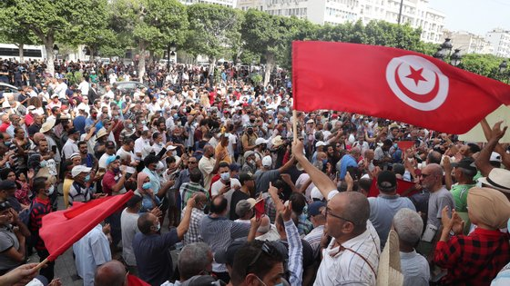 epa09474832 Opponents of Tunisia's President Kais Saied shout slogans as they take part in a protest against what they call his coup on 25 July, in Tunis, Tunisia, 18 September 2021. Tunisian President Saied suspended the country's parliament and dismiss the Prime Minister, Hichem Mechichi on 25 July 2021.  EPA/MOHAMED MESSARA