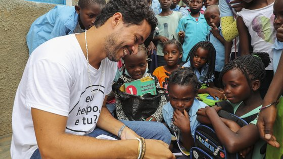 Leandro Martins, 31 years old Brazilian and Karibu project manager, talks to some of the students during the break. The NGO Helpo, through the Karibu project, supports 500 displaced students from the 2000s who are studying at the primary school in the Mahate neighborhood, in Pemba, Cabo Delgado province, April 14, 2021. The violence unleashed more than three years ago in Cabo Delgado province escalated again about two weeks ago, when armed groups first attacked the town of Palma, forcing people to flee from a conflict zone. JOAO RELVAS/LUSA