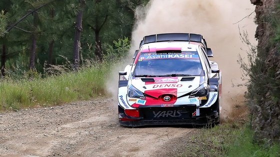 epa09217088 Sebastien Ogier of France drives his Toyota Yaris WRC during Day 2 of the Rally Portugal 2021 as part of the FIA World Rally Championship (WRC) near Lousa, Portugal, 21 May 2021.  EPA/PAULO NOVAIS