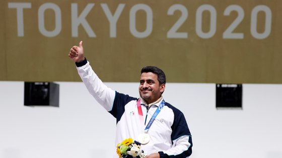 epa09361145 Gold medalist Javad Foroughi of Iran during medal ceremony for the Men's 10m Air Pistol final during the Shooting events of the Tokyo 2020 Olympic Games at the Camp Asaka in Nerima, Tokyo, Japan, 24 July 2021.  EPA/Michael Reynolds