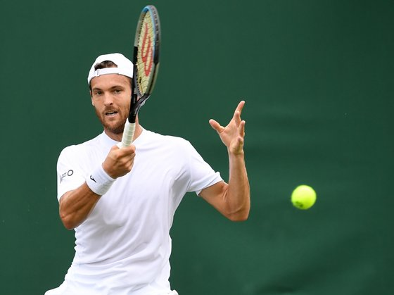 epa09308409 Joao Sousa of Portugal in action against Andreas Seppi of Italy during the 1st round match at the Wimbledon Championships, Wimbledon, Britain 28 June 2021.  EPA/FACUNDO ARRIZABALAGA