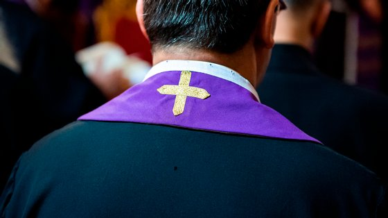 Priest wearing a purple stole in Rome, Italy.