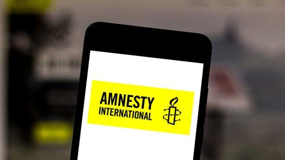 In this photo illustration a Amnesty International logo seen