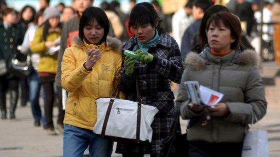Chinesas trabalham fora de casa mas não chegam ao topo