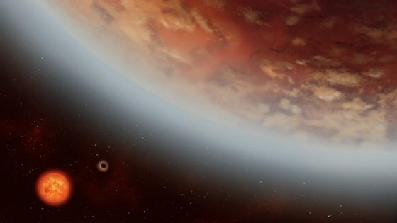 Os planetas K2-18 b e K2-18 c junto à estrela anã-vermelha, na constelação de Leão