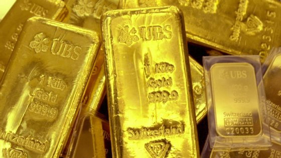 O que esconde o recorde na cotação do ouro, de quase 2.000 dólares. E até onde pode subir o metal precioso?