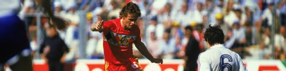 NANTES - JUNE 16:  Frank Vercauteren of Belgium is tackled by Luis Fernandez of France during the UEFA European Championships 1984 Group A match between Belgium and France held on June 16, 1984 at La Beaujoire, in Nantes, France. France won the match 5-0. (Photo by Trevor Jones/Getty Images)