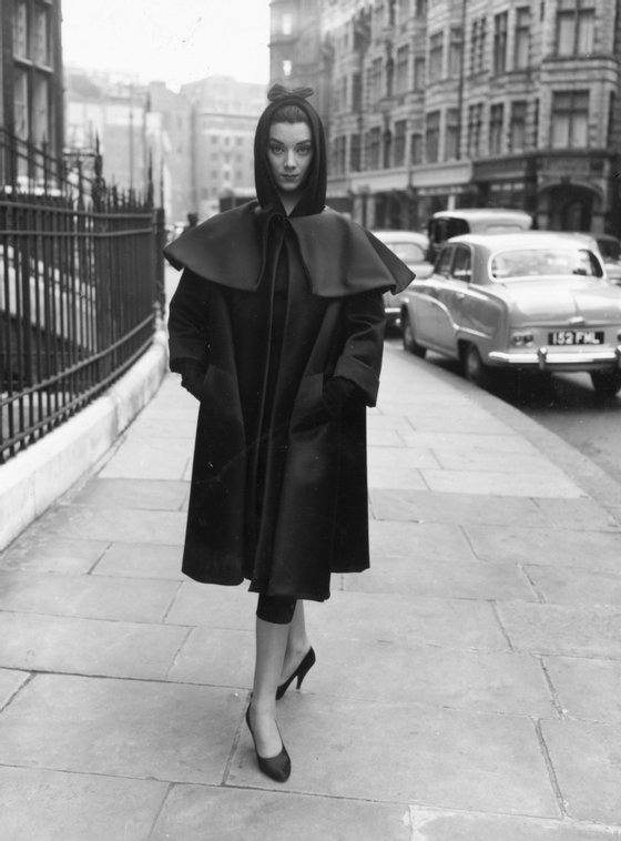 22nd February 1955:  A fashion model wearing a dress and coat by Balenciaga during rehearsals for an appearance on the television show 'Fashions From Paris'.  (Photo by Terry Fincher/Keystone/Getty Images)
