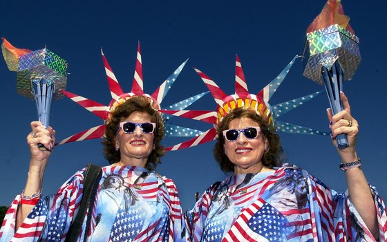 TWINSBURG, OH - AUGUST 3:  Dressed as the Statue of Liberty Jeanette Meadows and her twin sister Geneva Petitt pose for a photo August 3, 2002 at the Twins Days Festival in Twinsburg, Ohio.  (Photo by Mike Simons/Getty Images)