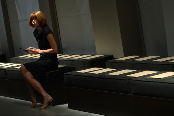 US Vogue editor in chief Anna Wintour sits alone on the front row prior the Bottega Veneta Spring-Summer 2013 collection on September 22, 2012 during the Women's fashion week in Milan.   AFP PHOTO / FILIPPO MONTEFORTE        (Photo credit should read FILIPPO MONTEFORTE/AFP/GettyImages)