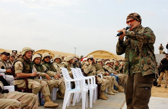BAGHDAD, IRAQ - DECEMBER 16:  Actor/comedian Robin Williams entertains the troops during the United Service Organizations (USO) tour at Baghdad International Airport on December 16, 2003.  (Photo by Lisa M. Zunzanyika/U.S. Air Force via Getty Images)