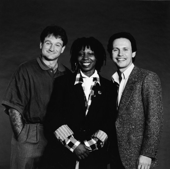 Promotional studio portrait of American comedians and Robin Williams, Whoopi Goldberg and Billy Crystal, the hosts of the 'Comedy Relief' variety benefit special, 1986.  (Photo by HBO/Getty Images)
