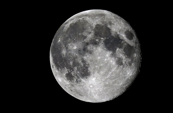 Photo of the full moon, on August 21, 2013 in Nice, southeastern France.  AFP PHOTO / VALERY HACHE        (Photo credit should read VALERY HACHE/AFP/Getty Images)