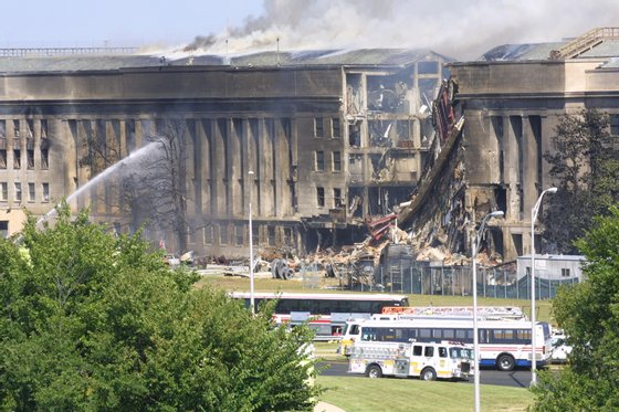 394262 07: Smoke comes out from the Southwest E-ring of the Pentagon building September 11, 2001 in Arlington, Va., after a plane crashed into the building and set off a huge explosion. (Photo by Alex Wong/Getty Images)