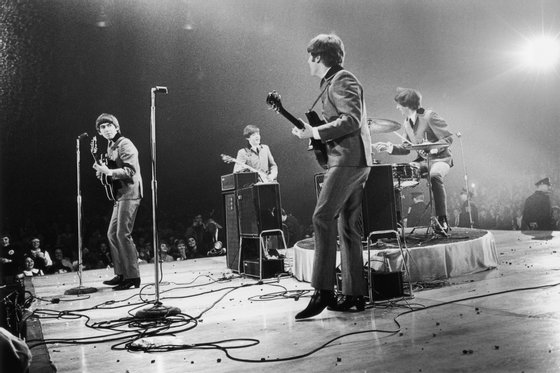 13th February 1964:  The Beatles in performance at the Washington Coliseum. Left to right : George Harrison (1943 - 2001), Paul McCartney, John Lennon (1940 - 1980) and Ringo Starr.  (Photo by Central Press/Getty Images)