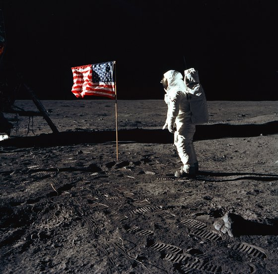 376713 03: (FILE PHOTO) Astronaut Edwin E. Aldrin, Jr., the lunar module pilot of the first lunar landing mission, stands next to a United States flag July 20, 1969 during an Apollo 11 Extravehicular Activity (EVA) on the surface of the Moon. The 30th anniversary of Apollo's moon landing is celebrated July 20, 1999. (Photo by NASA/Newsmakers)
