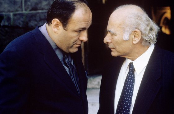 """387931 09: James Gandolfini as Tony Soprano and Burt Young as Bobby """"Bacala"""" Baccalieri, Sr. act in a scene in HBO's hit television series, """"The Sopranos"""" (Year 3). (Photo by HBO)"""