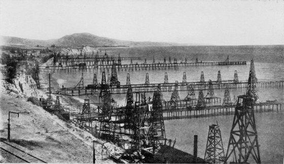 Oil_wells_just_offshore_at_Summerland,_California,_c.1915