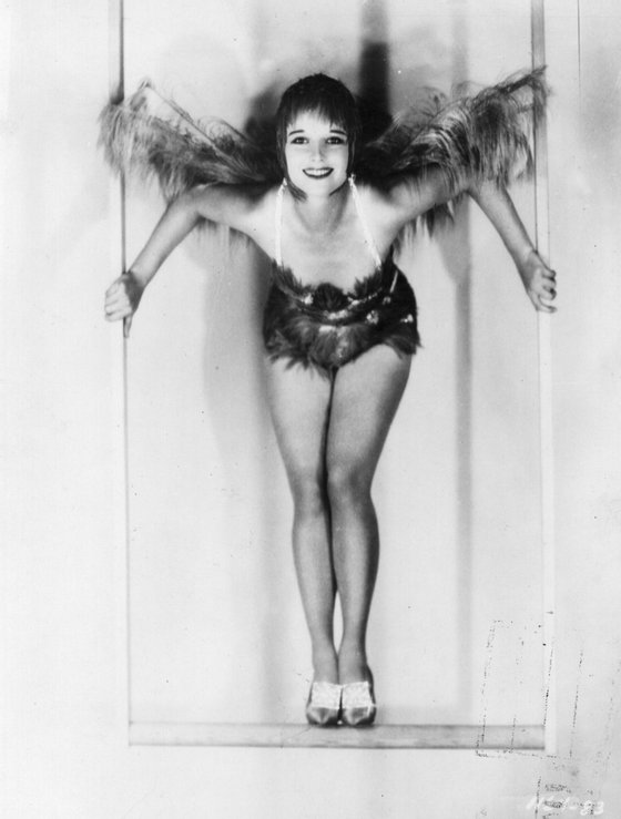 Louise Brooks (1900 - 1985), American film star on a trapeze which she had fitted into her Hollywood home. (Photo by General Photographic Agency/Getty Images)