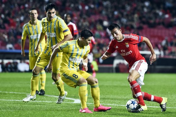 Benfica's Argentinian midfielder Nico Gaitan (R) vies with Astana's midfielder Georgi Zhukov (C) during the UEFA Champions League football match SL Benfica vs FC Astana at the Luz stadium in Lisbon on September 15, 2015. AFP PHOTO/ FRANCISCO LEONG (Photo credit should read FRANCISCO LEONG/AFP/Getty Images)