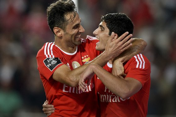 Benfica's Brazilian forward Jonas Oliveira (L) celebrates with his teammate Benfica's forward Goncalo Guedes (R) after scoring during the Portuguese league football match SL Benfica vs FC Pacos de Ferreira at the Luz stadium in Lisbon on September 26, 2015. AFP PHOTO / PATRICIA MELO MOREIRA (Photo credit should read PATRICIA DE MELO MOREIRA/AFP/Getty Images)