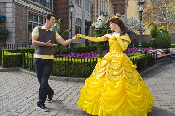 """LAKE BUENA VISTA, FL - FEB 23: In this handout image provided by Disney, Tony Dovolani, one of the professional dancers starring on the ABC-TV series """"Dancing with the Stars,"""" joins Belle, the princess from Disney's """"Beauty and the Beast,"""" for a dance at the France pavilion in the Epcot theme park on February, 23 in Lake Buena Vista, Florida. The Albanian-born dancer will be back on the reality show when it makes its season premiere March 21, 2011 on ABC-TV. Epcot is one of four theme parks at Walt Disney World Resort in Florida. (Photo by Matt Stroshane/Disney via Getty Images)"""