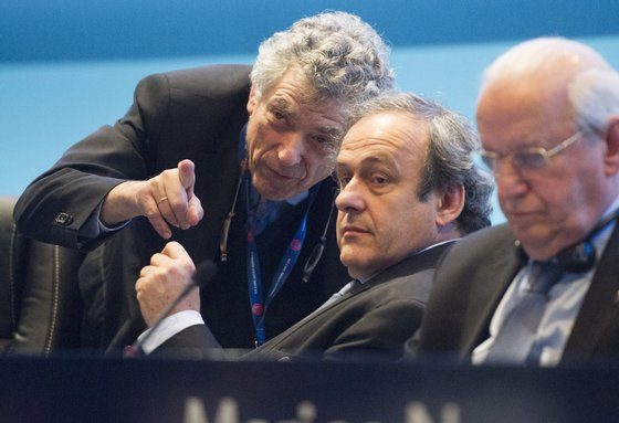 Newly re-elected UEFA president Michel Platini (C) speaks to Angel Maria Villar Llona (L) at the Ordinary UEFA Congress in Vienna, Austria on March 24, 2015. The annual congress of European football's governing body is expected to focus on elections for UEFA Presidency, UEFA Executive Committee and FIFA Executive Committee. AFP PHOTO / JOE KLAMAR (Photo credit should read JOE KLAMAR/AFP/Getty Images)