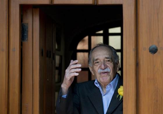 Nobel Literature prize-winning writer and journalist, Colombian Gabriel Garcia Marquez, waves while coming out from his house to meet the press during his 87th birthday, in Mexico City, on March 6, 2014. AFP PHOTO / Yuri CORTEZ (Photo credit should read YURI CORTEZ/AFP/Getty Images)