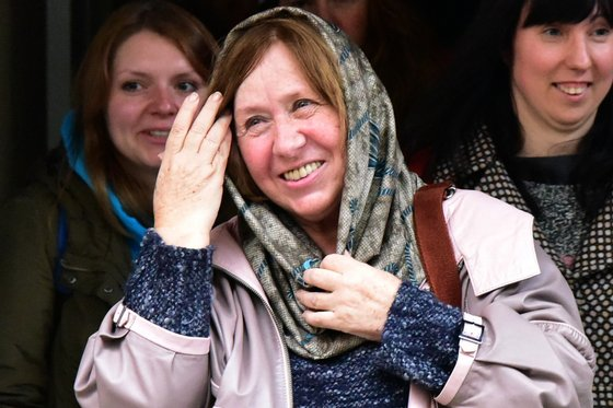 Belarus writer and journalist Svetlana Alexievich leaves after giving a press conference in Minsk, on October 8, 2015, following the announcement of her Nobel Literature Prize earlier in the day. Belarussian writer Svetlana Alexievich said on October 8 she was dedicating her Nobel prize for literature to her homeland -- where her books cannot be published -- blasting strongman rule there and in neighbouring Russia. AFP PHOTO / MAXIM MALINOVSKY (Photo credit should read MAXIM MALINOVSKY/AFP/Getty Images)
