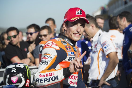 VALENCIA, SPAIN - NOVEMBER 07: Marc Marquez of Spain and Repsol Honda Team celebrates at the end of the qualifying practice during the MotoGP of Valencia - Qualifying at Ricardo Tormo Circuit on November 7, 2015 in Valencia, Spain. (Photo by Mirco Lazzari gp/Getty Images)