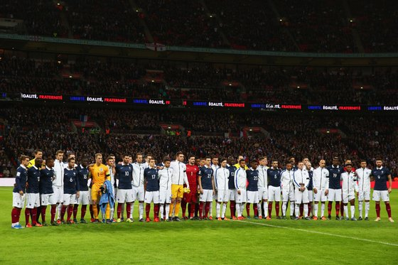LONDON, ENGLAND - NOVEMBER 17: Both teams stand together for a moment of applause prior to the International Friendly match between England and France at Wembley Stadium on November 17, 2015 in London, England. (Photo by Paul Gilham/Getty Images)