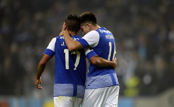 Porto's Mexican midfielder Hector Herrera (R) celebrates after scoring a goal with teammate Mexican forward Jesus Corona during the Portuguese league football match FC Porto vs A. Academica de Coimbra at the Dragao stadium in Porto on December 20, 2015. Porto won the match 3-1. AFP PHOTO / MIGUEL RIOPA / AFP / MIGUEL RIOPA (Photo credit should read MIGUEL RIOPA/AFP/Getty Images)