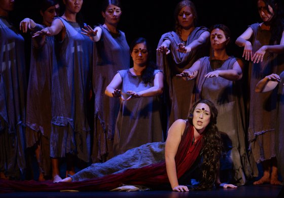 """Swedish soprano Paulina Pfeiffer (Front) performs during a full dress rehearsal of the Opera """"A Flowering Tree"""" at the Chatelet theater on May 2, 2014 in Paris. The Opera by composer John Adams and staged by Indian director and screenwriter Vishal Bhardwaj, is inspired by a southern Indian folk tale describing the trials and tribulations of a young couple to demonstrate the power of love. It shows through May 5 - 13, 2014 at the Chatelet theater in Paris. AFP PHOTO / PIERRE ANDRIEU (Photo credit should read PIERRE ANDRIEU/AFP/Getty Images)"""