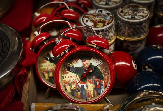 BEIJING, CHINA - SEPTEMBER 07: Alarm clocks showing the late Chinese leader Mao Zedong are seen for sale at a vendor's stand at a market on September 7, 2014 in Beijing, China. Chairman Mao, a Communist revolutionary and founding father of the People's Republic of China, led the country until his death September 9, 1976. Mao's ideology, though at times controversial, still wields influence over the leadership of modern China. (Photo by Kevin Frayer/Getty Images)