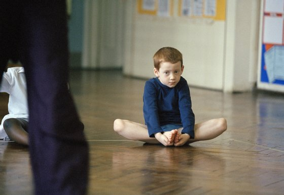 UK - Education - Stretching during a PE class