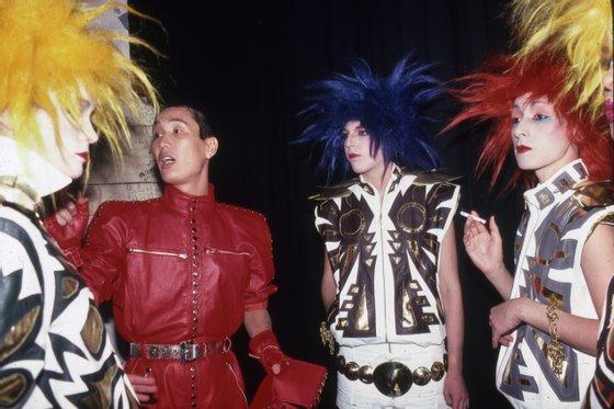 Kansai Yamamoto, backstage at 57th St. Roller Rink, New York - '80s