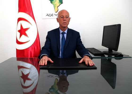 epa07846950 Tunisian presidential candidate Kais Saied poses for a photo at his campaign headquarters in Tunis, Tunisia, 16 September 2019. According to reports, preliminary results showed presidential candidates Kais Said, a 61-year-old law professor, and imprisoned businessman Nabil Karoui are leading the first round of voting and expected to face off in the second round in October. EPA/MOHAMED MESSARA