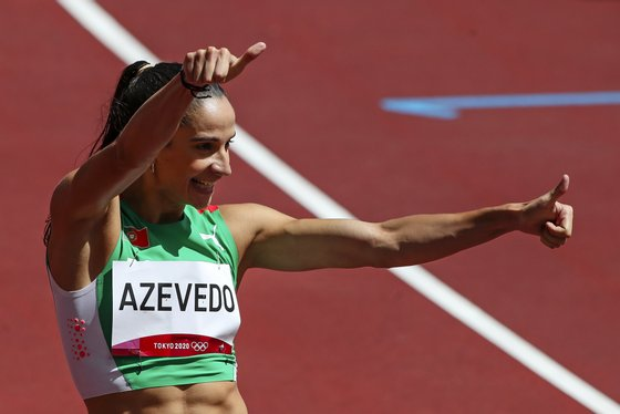 A portuguesa Cátia Azevedo durante a prova de qualificação para as semifinais dos 400 metros dos Jogos Olímpicos Tóquio2020, Estádio Olímpico, Tóquio, Japão, 3 de agosto de 2021. A velocista qualificou-se hoje para as semifinais dos 400 metros dos Jogos Olímpicos Tóquio2020, ao terminar a segunda série no terceiro lugar, com o tempo de 51,26 segundos. JOSÉ COELHO/LUSA