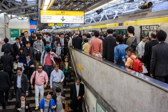 Commuters exit the platform at Shinjuku station, said to be