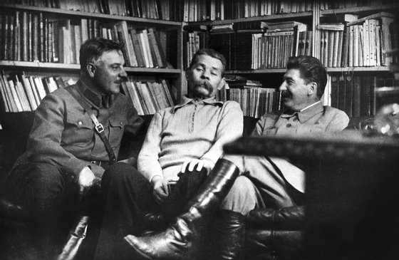 joseph stalin and kliment voroshilov visiting writer maxim gorky (center), 1931.