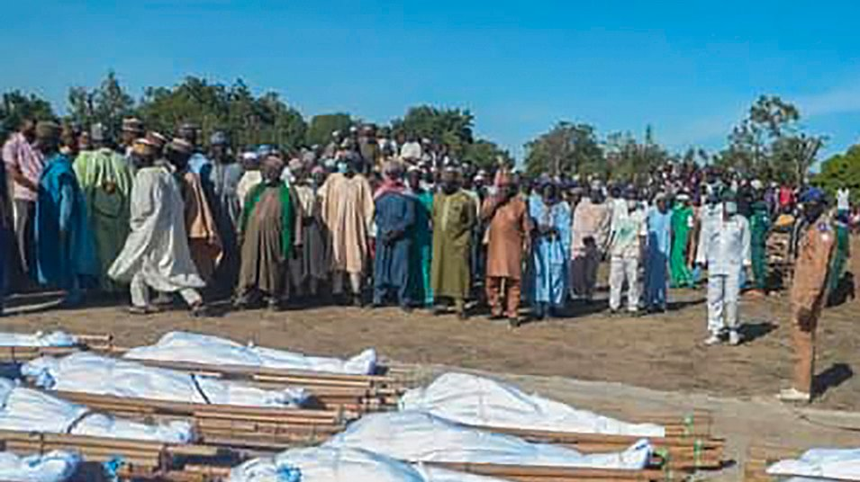 epa08851189 Nigerians attend a mass burial of farm workers killed in an attack at Zabarmari, Borno State, northeast Nigeria, 29 November 2020. According to reports, 43 farm workers in Zabarmari were killed by Boko Haram fighters in fields near Koshobe on 28 November 2020. The attackers tied up the farm workers and cut their throats in the village of Koshobe leaving many of them beheaded.  EPA/STR